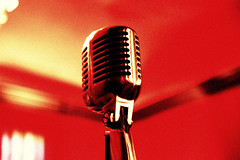 microphone(1.0), electronic device(1.0), red(1.0), audio equipment(1.0),