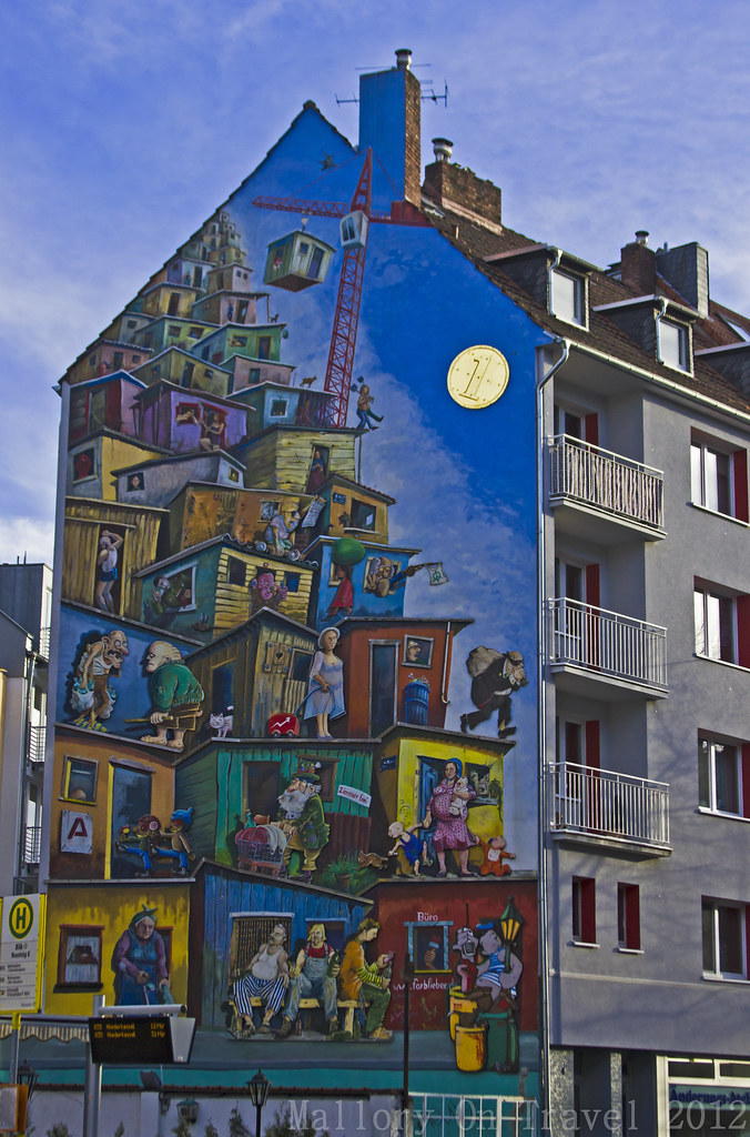 Sightseeing in Dusseldorf, a street mural on the side of a building on Mallory on Travel, adventure, adventure travel, photography Iain Mallory-300-5