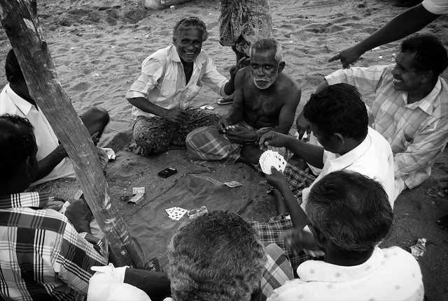 People in India: Fisherman Gambling on Sunday