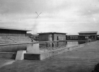 Concourse grandstand and changing sheds at the new Mount Isa swimming pool  1949