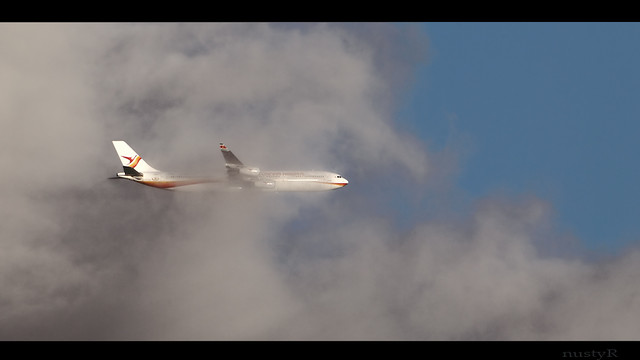 PZ-TCP Surinam Airways A340 cloudbusting after take off from EHAM Schiphol