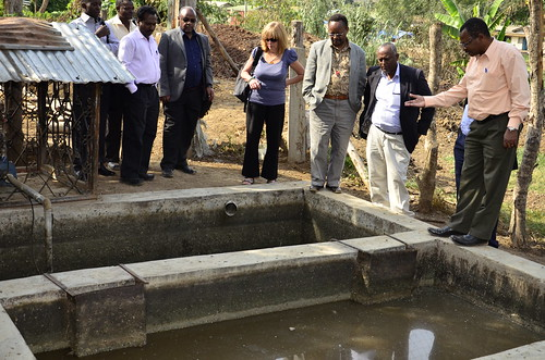 Adolf Olomi taking the team through his wastewater disposal sytem that has become unmanageable