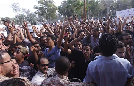 Libyans overrun the US-backed General National Congress parliament in Tripoli protesting the siege of Bani Walid. The town is being shelled by the rebel regime installed by Washington last year. by Pan-African News Wire File Photos