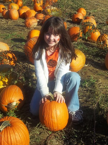 Julia pickes her pumpkin