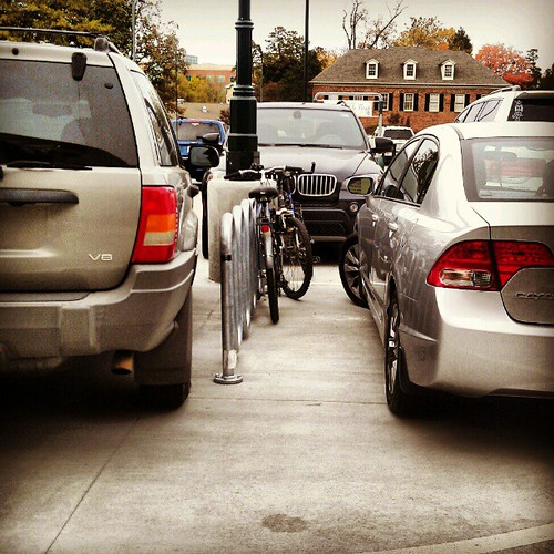 Nothing says Charlotte like having to squeeze your bikes between two cars in the bike spot.