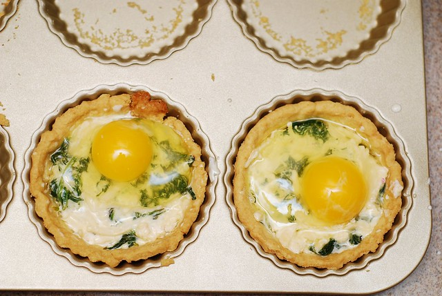 tart shells with egg on top