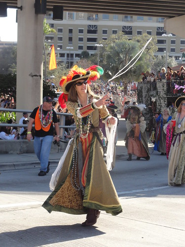 Woman throwing beads