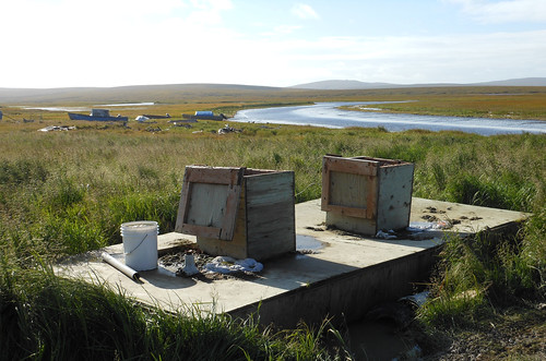Common waste collection sites on the Alaskan tundra.  USDA, with its partners, is working to retire systems like this and replace them with safe, sanitary water and sewer systems.