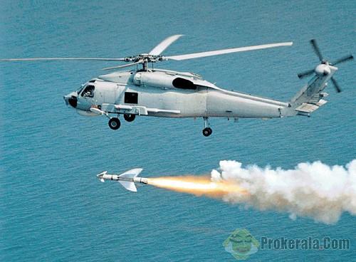 a-sikorsky-mh-70b-variant-firing-anti-ship-missile-30839 by Dav yadav