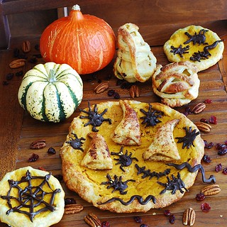 Pumpkin tart with apple-cranberry stuffed crust, chocolate bugs and wizard hats
