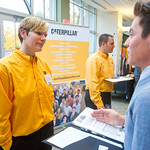 IF6 -- Internship Fair. Caterpillar rep Le Ann McQuellon '99 with Leo Martinez '15.