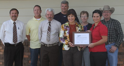 (left to right) Tim Potts - Rural Development Area Director; Rusty Olney - Corporation Member; Kadoka Mayor Harry Weller; Rich Bendt - Corporation Member; Elsie Meeks - Rural Development State Director; Eileen Stolley – Corporation Member; JoBeth Uhlir - Director of Operations; and Dale Christensen - Corporation Member.