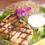 Katherine-Rhoades-Food -- Ono is a popular fish caught on the shores of Hawai'i. This Ono featured in this entree from the Kona Kanoe Club was caught fresh that morning and served with brown rice and fresh steamed vegetables. It was then garnished with a native Hawaiian flower. - Katherine Rhoades