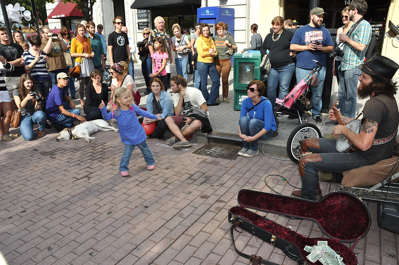 Girl Dancing with Banjo Player in Grand Rapids Fall October 2012 During ArtPrize
