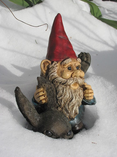 Garden gnome riding a rabbit