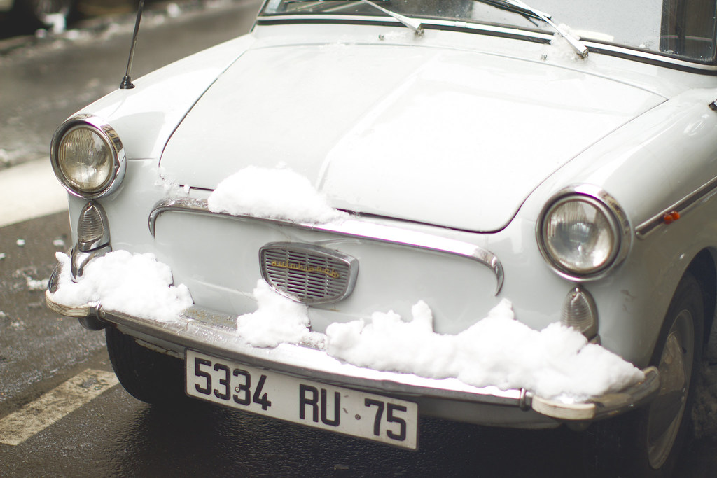 vintage car in the snow in Paris
