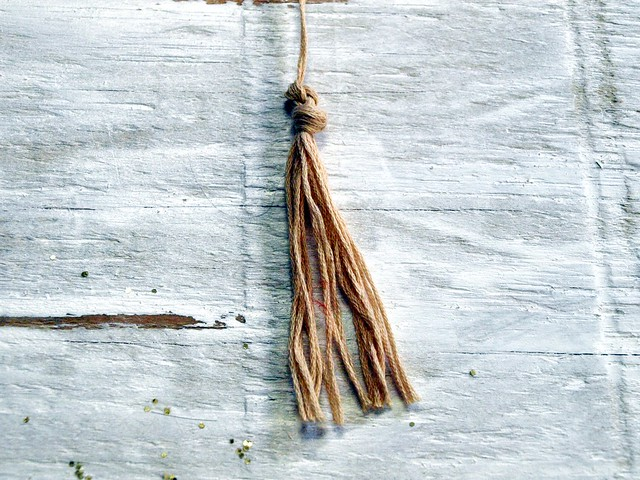 hanging bird sculpture tassle
