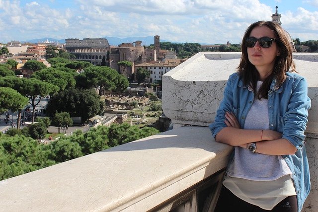 on top of Vittorio Emanuele II Monument with the Colosseum in the background, Rome