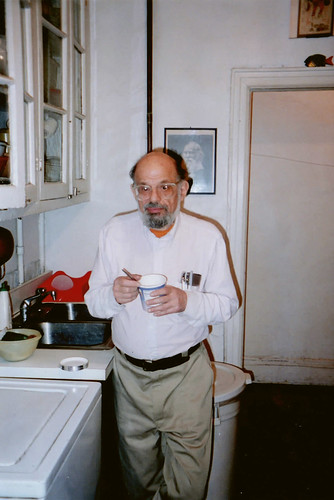 Allen Ginsberg in Kitchen, East Village, New York, in front of picture of Walt Whitman, 1995. Photo by Geoff Manaugh