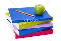 green apple and pencil on top of books