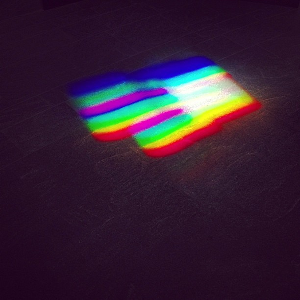 There are prisms built into the walls that cast rainbows everywhere