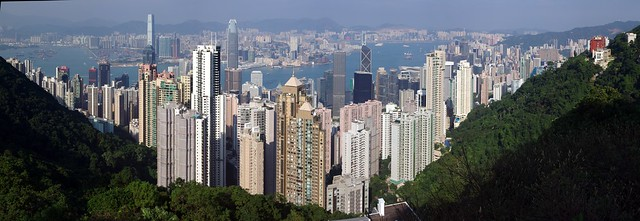 Hong Kong Skyline Panorama - viewed from steep Old Peak Road forest walk up to Victoria Peak