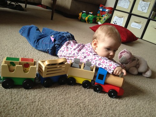 Dakota playing with a train.