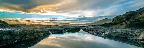 ocean california sunset reflection beach water clouds rocks solitude illumination calm coastline centralcoast pismobeach tidepool shellbeach
