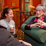 12-070 -- At the Kemp Hall/International House reunion, Helen Shelton '40 tells stories about Illinois Wesleyan during her days as a student to Katie Rotha '14, who lives in the same room that Helen occupied.