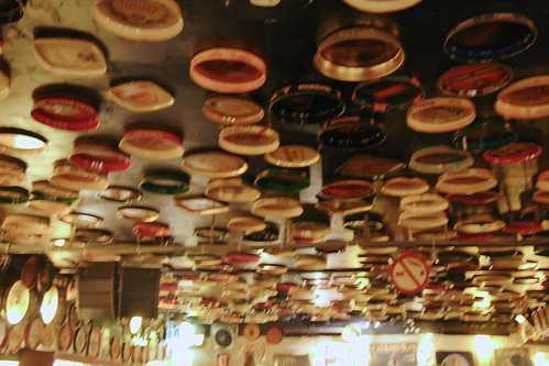 Branded Serving Trays On Ceiling At Delirium Cafe
