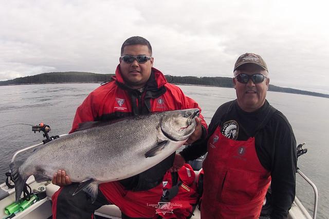 Big men catching big fish at langara fishing lodge for Catching big fish