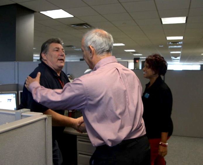 2_Larry_Greets_Workers