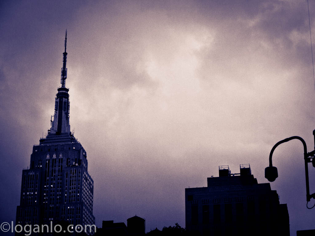 Empire State Building against a cloudy sky