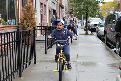 Boy on bicycle after Hurricane Sandy