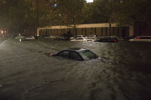 A vehicle sits submerged on 14th Street near the Consolidated Edison power plant in New York