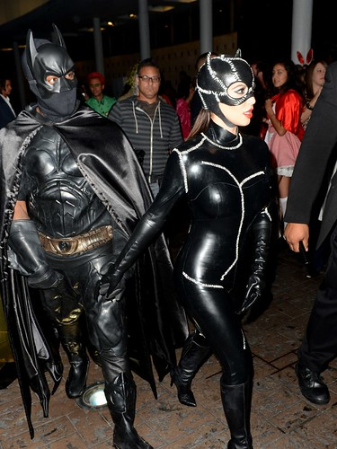 Kanye West and Kim Kardashian batman & Cat woman halloween costumes. kanye and kim hop out a gold lambo