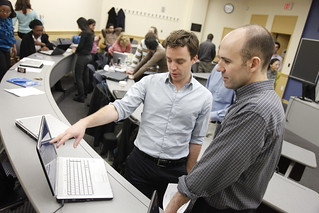 Image of Prof. Andy Molinsky talking with a student