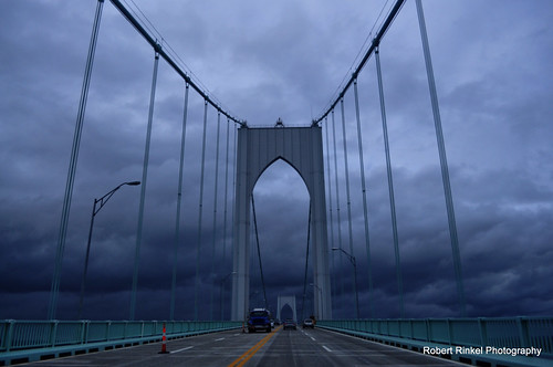 Pell Bridge, Newport Rhode Island, looking west, Tuesday after Hurricane Sandy with ominous parting clouds. by robert.rinkel