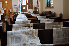 At Mazel Academy in Brooklyn, Torah scrolls were unrolled to dry after being damaged by the floodwaters from Hurricane Sandy. Photo by Ben Harris.