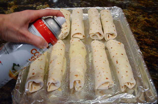 The taquitos are sprayed with cooking spray.
