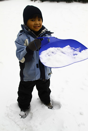 shovel, ski jacket and salopette snow fun