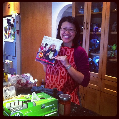AC and some of her birthday gifts (book and apron)!