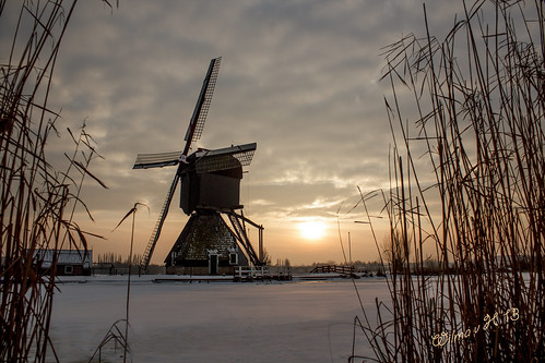 Snow-dusted Windmill at Kinderdijk - 2013   - Best viewed on a black screen - Featured on Explore #12 - 29-01-13 (thanks for this wonderful reward!)