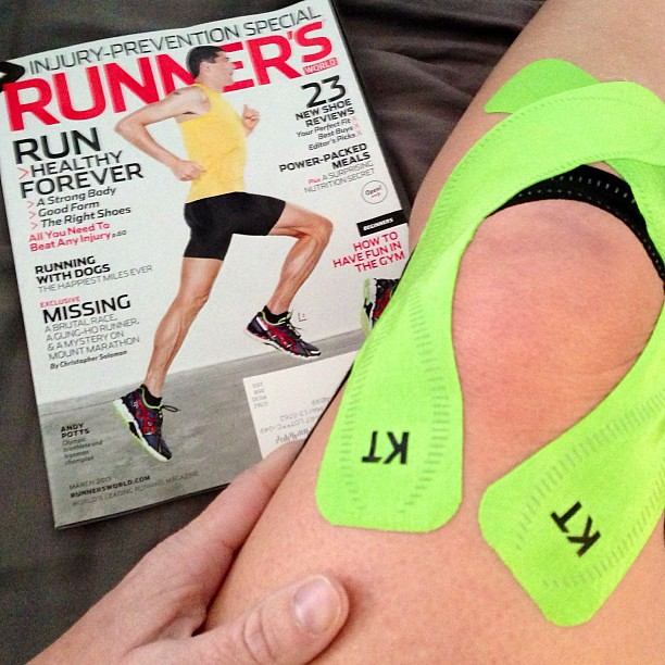 "Irony. Knee injury taped with @kttape after physical therapy & @runnersworld ""Injury Prevention Special"" issue which came in the mail yesterday."
