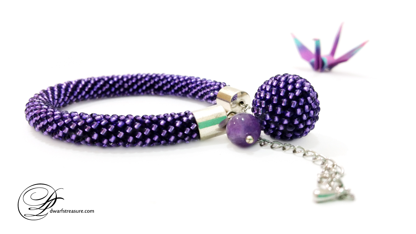 custom made ultraviolet beaded crochet bracelet with amethyst bead charm and origami paper crane