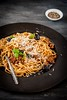 Pasta with Tomato Pesto, Black Olives and Pine Nuts