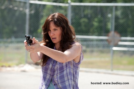 Lori Grimes (played by Sarah Wayne Callies) with her gun