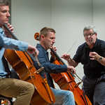 12-054b -- Andrew Hesse '06 (left) and Chris Frey '96 rehearse a cello duet for Friday's Illinois Wesleyan Civic Orchestra Concert, conducted by Professor of Music Steven Eggleston.