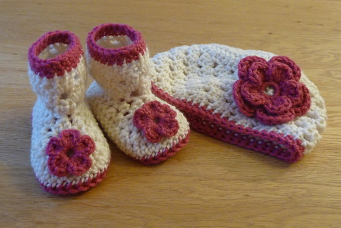 Matching crochet baby booties and hat set