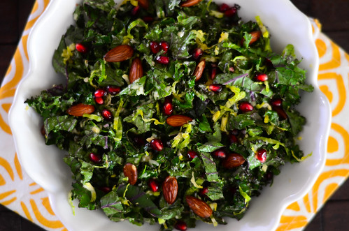 kale and brussels sprout salad with pomegranate and almonds